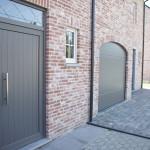 Sleutel-op-de-deur-nieuwbouw-halfopen-bebouwing-voorgevel-voordeur-garagepoort
